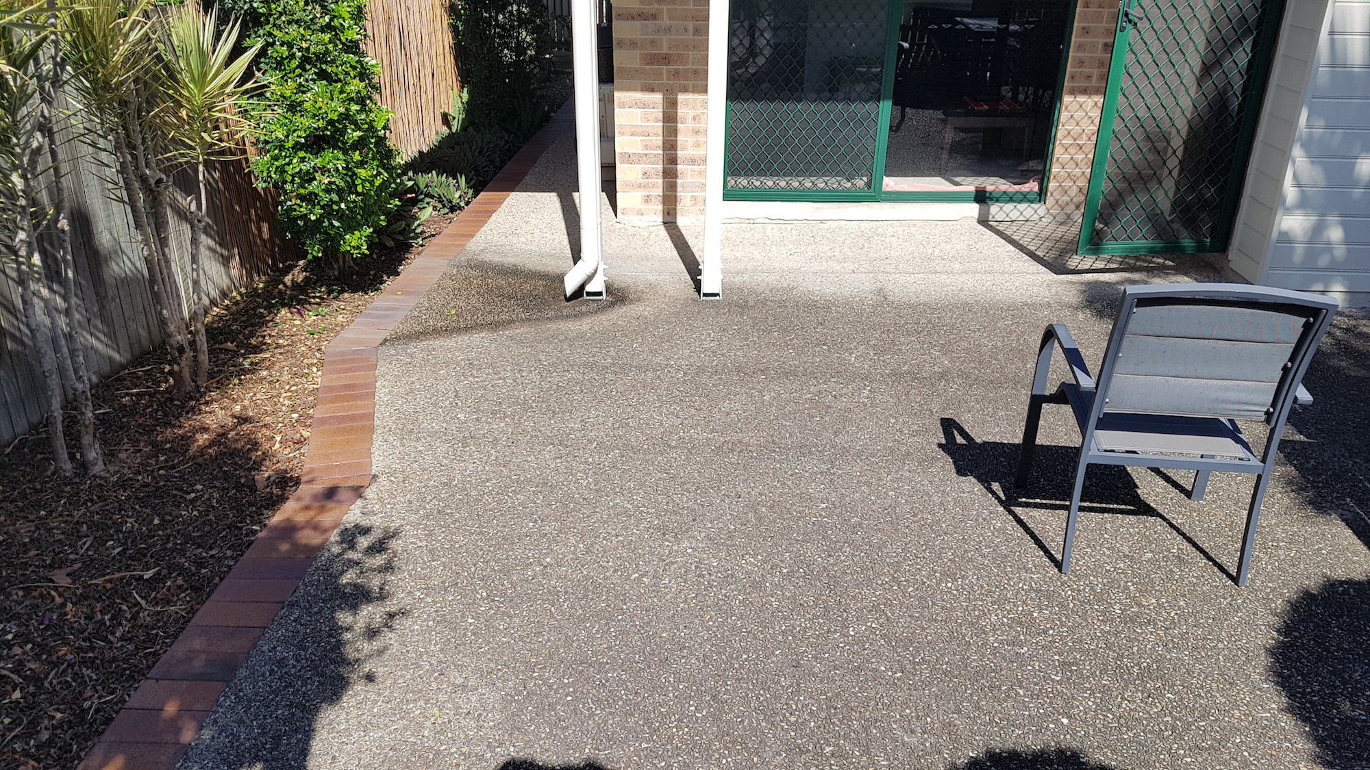 Exposed aggregate concrete courtyard - dirty, mouldy & slippery