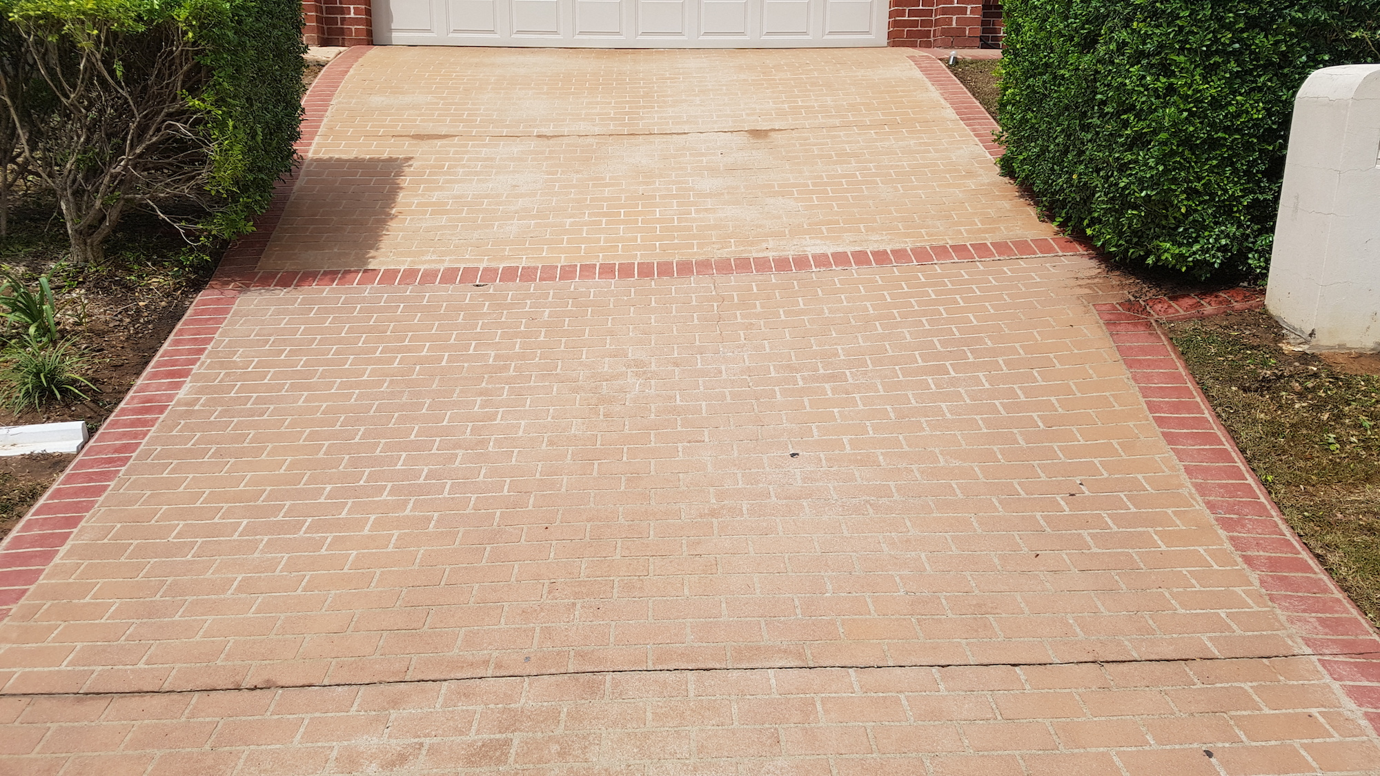 Coloured concrete driveway - after low pressure cleaning